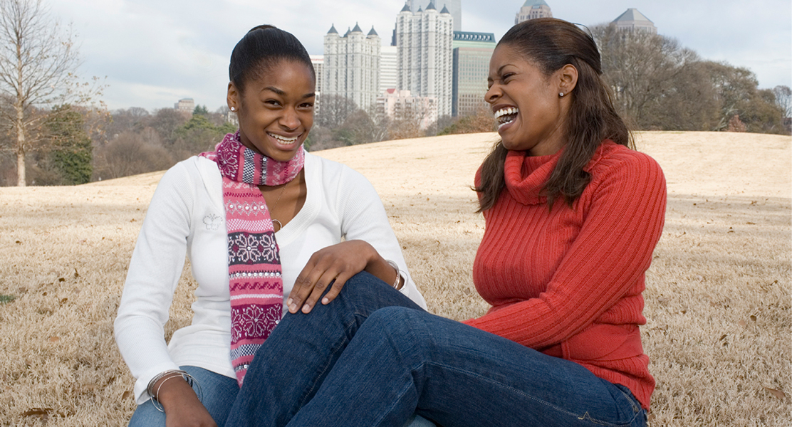 Young girl and her mother laughing